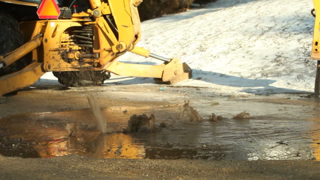 Water Main Break Under City Street