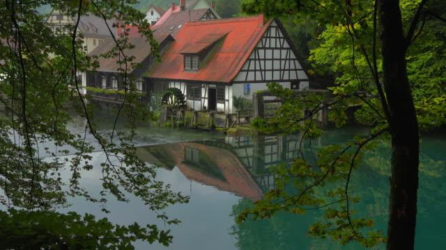 water mill at blautopf spring, blaubeuren, swabian alb, baden-wuerttemberg, germany - spring flowing water stock videos & royalty-free footage