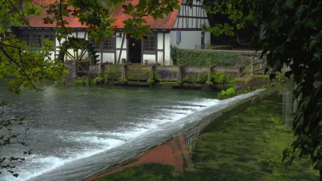 water mill at blautopf spring, blaubeuren, swabian alb, baden-wuerttemberg, germany - watermill stock videos and b-roll footage