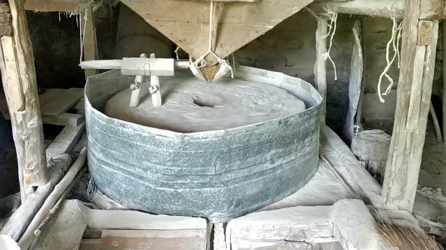 water mill stone is grinding - watermill stock videos & royalty-free footage