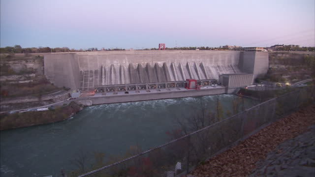 water moves through a hydroelectric plant on the niagara river. - wasserkraft stock-videos und b-roll-filmmaterial