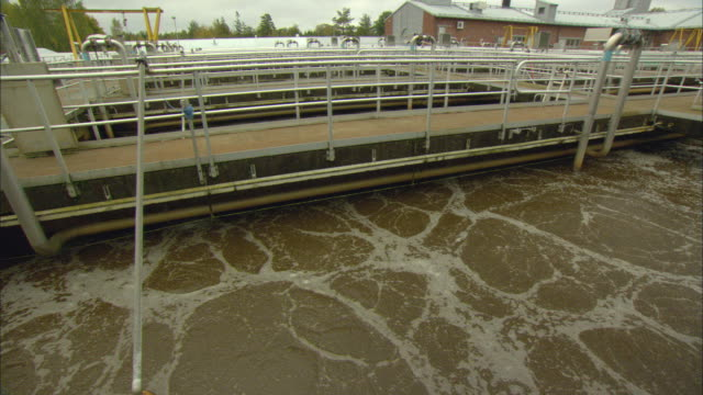 ws water moving in large pool at sewage water treatment plant / vaxjo, sweden - vaxjo stock videos & royalty-free footage