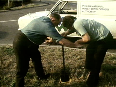water officials turn off a stop cock in a street during the 1976 drought crisis - 1976 stock videos and b-roll footage