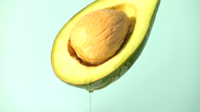 Water or oils drop from avocado