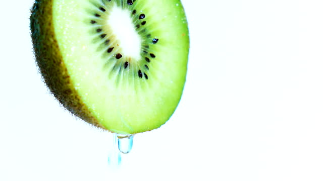 water or oils drop on kiwi fruit - kiwi fruit stock videos and b-roll footage