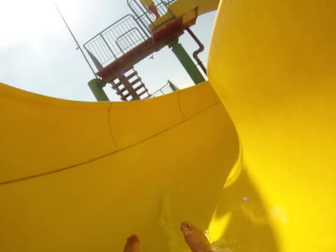 water park, slope down - ntsc - water slide stock videos & royalty-free footage
