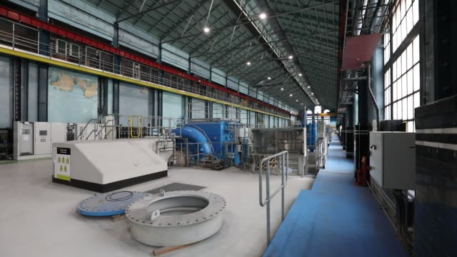 stockvideo's en b-roll-footage met water pipes make their way towards the lochaber aluminum smelter, operated by liberty house group, in fort william, uk, on monday, feb 6 turbines... - hoogoven