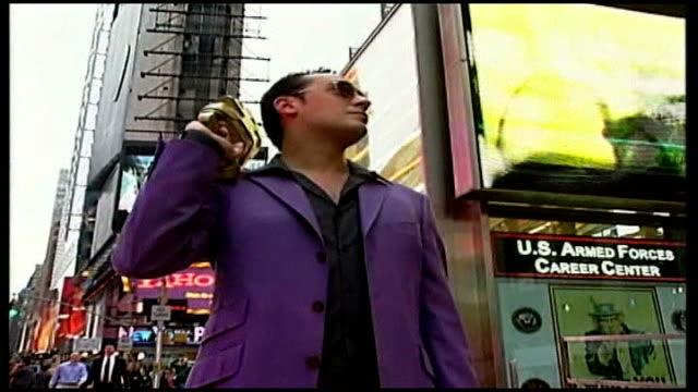 water pistol 'street wars' craze sweeps new york; ext 'street wars' contestant wearing silver shoes, purple suit carrying a gold water pistol tilt up... - water pistol stock videos & royalty-free footage