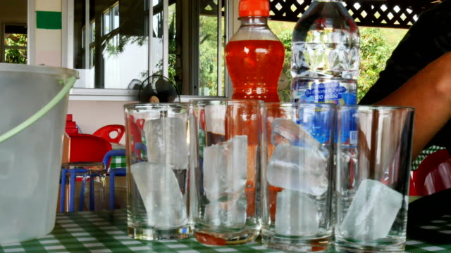 water pouring from a pitcher into a glass - pitcher jug stock videos & royalty-free footage