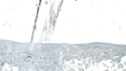 Water Pouring Macro Footage. White Background