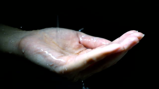Water pouring on woman hand