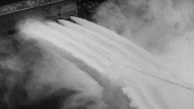 ws water pouring  out of hydro electric dam / united states - 1930 stock-videos und b-roll-filmmaterial
