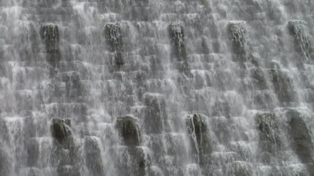 cu,  water pouring over dam,  ellan valley,  wales,  england - hydroelectric power stock videos & royalty-free footage