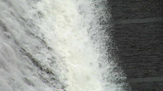 CU,  water pouring over dam wall,  Ellan Valley,  Wales,  England