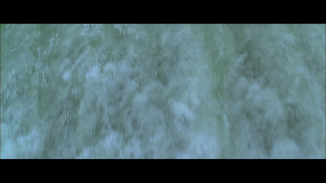 cs water pouring over the lip of horseshoe falls, with a viewing platform and the city's high-rise buildings beyond / niagara falls, ontario, canada - floating moored platform stock videos & royalty-free footage