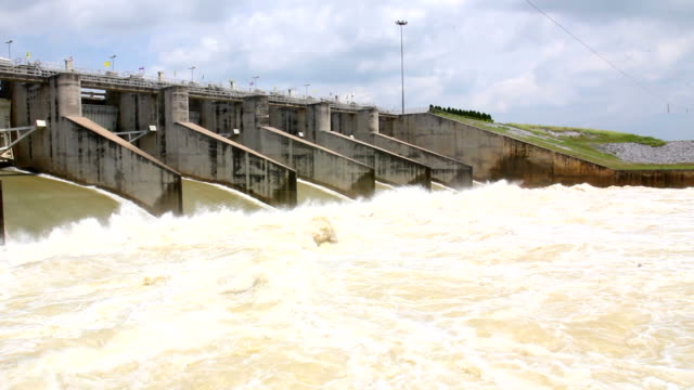 water pouring through the water gates compacted concrete dam - embankment stock videos and b-roll footage
