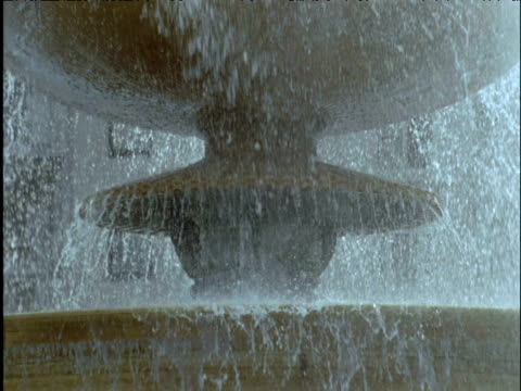 Water pours from fountain Trafalgar Square London