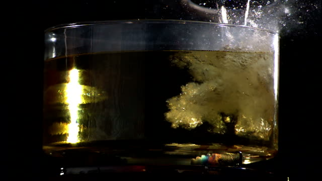 water pours into a pot of hot liquid, causing an explosion. - overflowing stock videos & royalty-free footage
