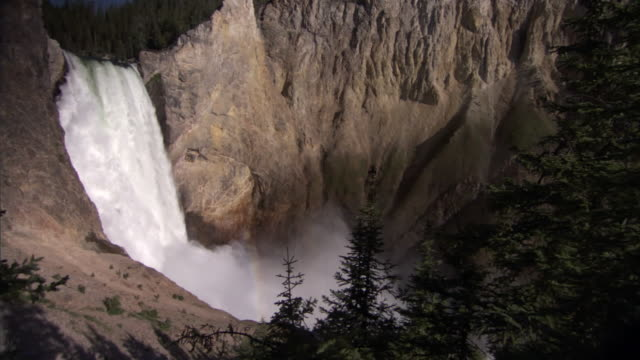 water pours over lower yellowstone falls, yellowstone, usa - lower yellowstone falls stock videos & royalty-free footage