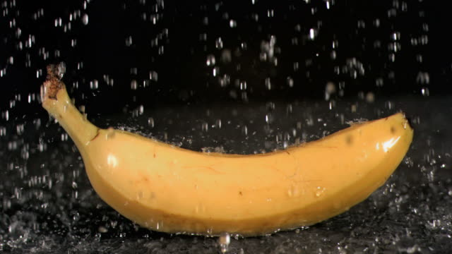 water raining on banana in super slow motion - slip banana stock videos & royalty-free footage