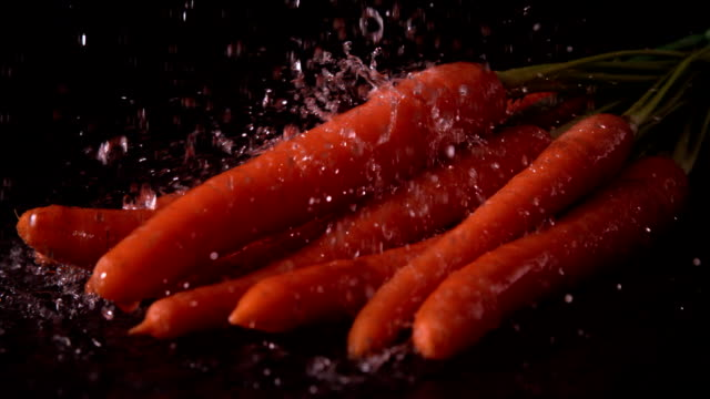 water raining on carrots - carrot stock videos and b-roll footage