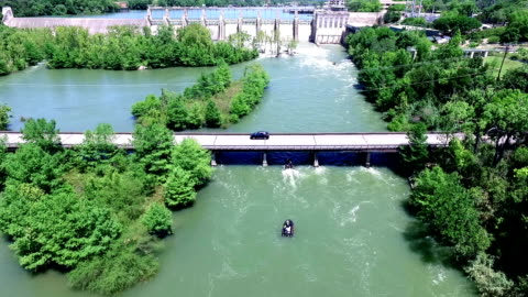 water rescue team drills on the colorado river during high flood zone - emergency planning stock videos & royalty-free footage