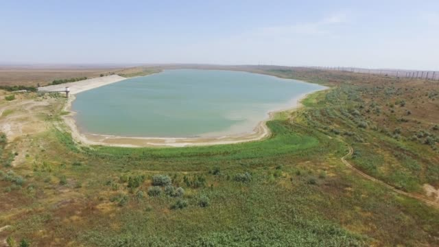 aerial: water reservoir in countryside - reservoir stock videos and b-roll footage
