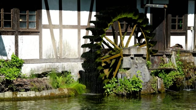 water rich source of the river blue with watermill, blautopf, blaubeuren, swabian alb, baden-württemberg, germany - mill stock videos & royalty-free footage