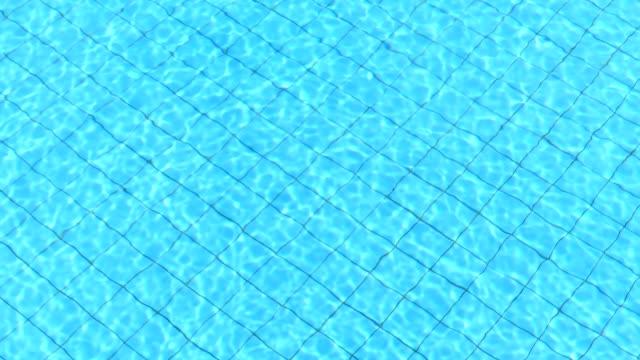 vidéos et rushes de ondulation de l'eau dans la piscine - station de vacances