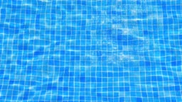 water ripples in swimming pool tile background