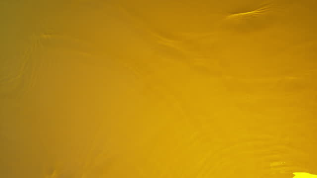 water ripples on yellow background - illustration stock videos & royalty-free footage