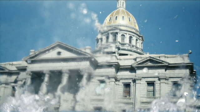 water rises above thecolorado state capitol in a computer-generated animation. - pediment stock videos & royalty-free footage