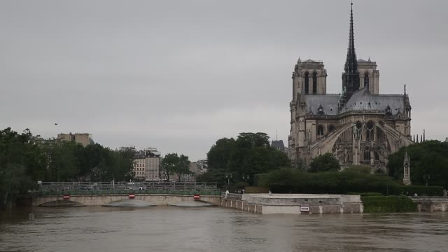 water rises as the seine river's embankments overflow after four days of heavy rain on june 2 2016 in paris france northern france is experiencing... - cathedral stock videos & royalty-free footage