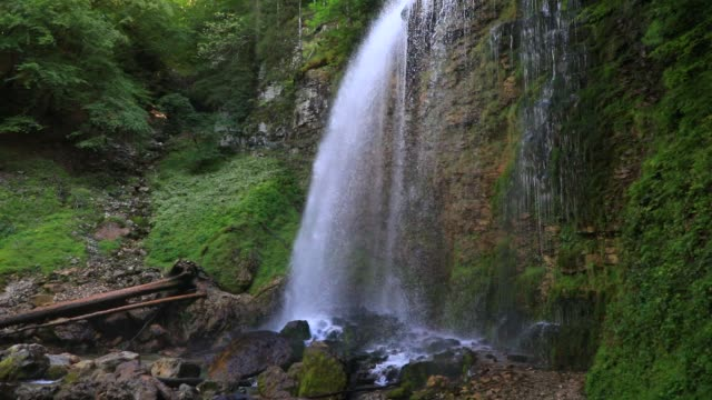 """water runs from the waterfall at """"cirque de saint meme"""" a popular tourist site on september 3, 2020 in saint pierre d entremont, france. the 'cirque... - eco tourism stock videos & royalty-free footage"""