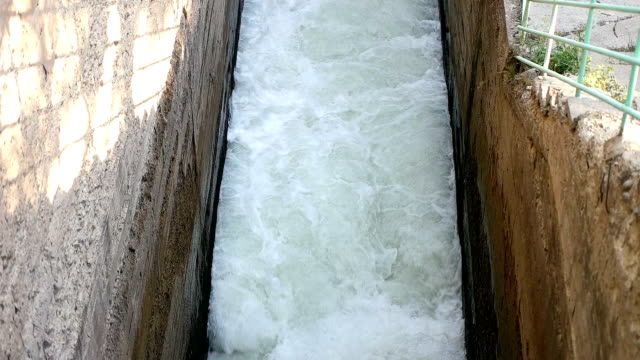 water rushing out of hydro dam - power station stock videos & royalty-free footage