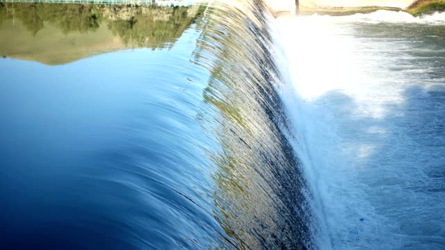 water rushing out of hydro dam - reservoir stock videos and b-roll footage