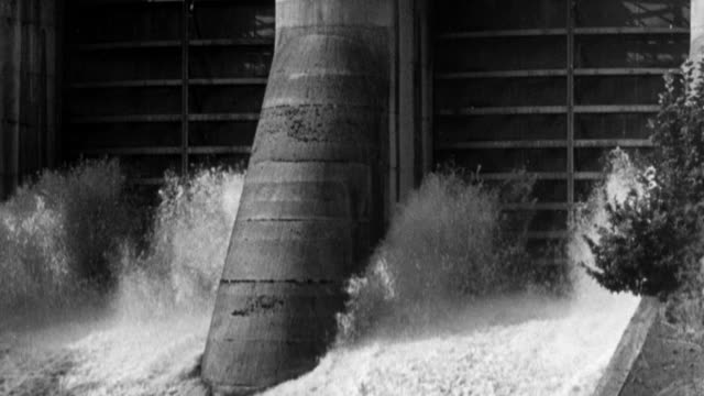 stockvideo's en b-roll-footage met 1949 montage water rushing through the flood gates of a dam / united kingdom - waterkracht