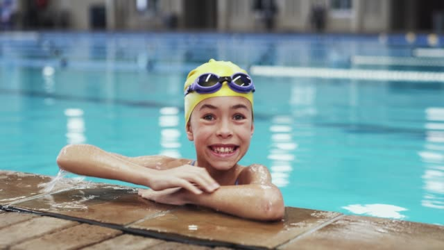 water safety starts young - girl swimming costume stock videos & royalty-free footage