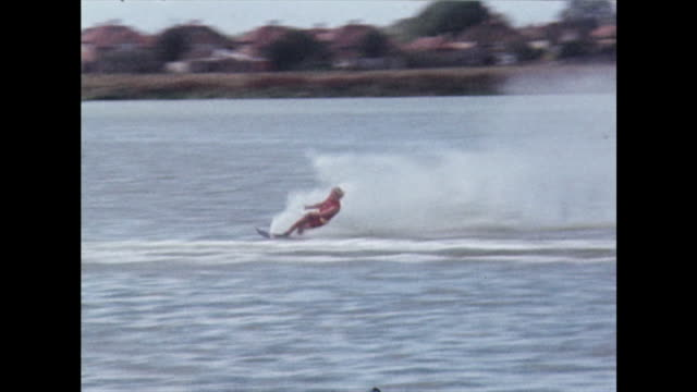 water skier on a single ski at uk competition event; 1970 - life jacket stock videos & royalty-free footage
