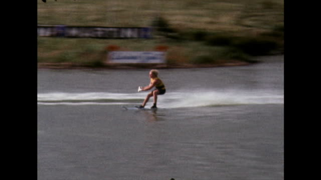 water skier performs a jump over a ramp at uk competition event; 1970 - life jacket stock videos & royalty-free footage