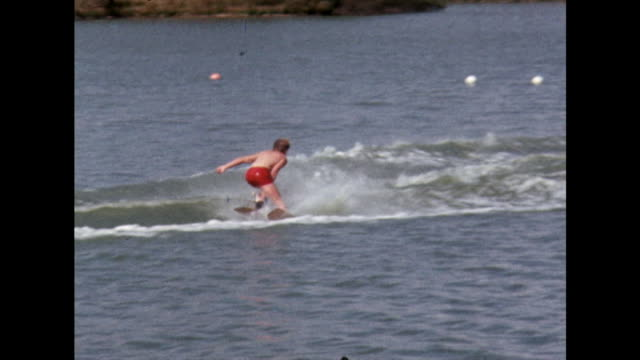 water skier performs tricks at uk competition event; 1970 - speed boat stock videos & royalty-free footage