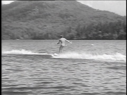 1951 montage water skiers jump over a ramp at mirror lake national water ski championships / lake placid, new york, united states - 1951 stock videos & royalty-free footage