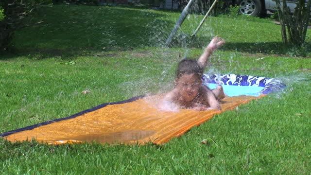 water slide - water slide stock videos & royalty-free footage