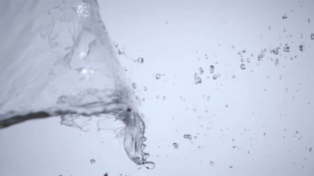 MS SLOW MOTION Water splash being thrown across white background/ New York, New York
