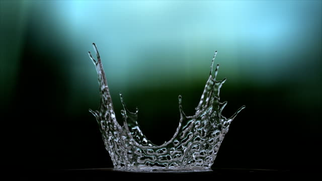 water splash from bottom in slow motion whit alpha - crown headwear stock videos & royalty-free footage