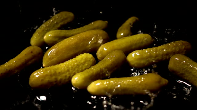 water splash on pickled cucumbers - pickled stock videos and b-roll footage