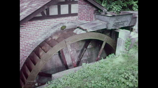 ms water splashing on mill water wheel / united states - water wheel stock videos and b-roll footage