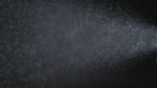 water spray against black background - black background stock videos & royalty-free footage