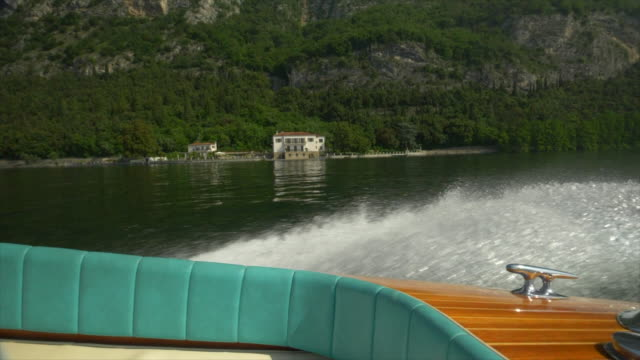 water spray from a classic luxury wooden runabout boat on an italian lake. - 唯一点の映像素材/bロール