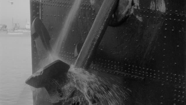 water sprays a ship's anchor as it is raised. - harbour stock videos & royalty-free footage